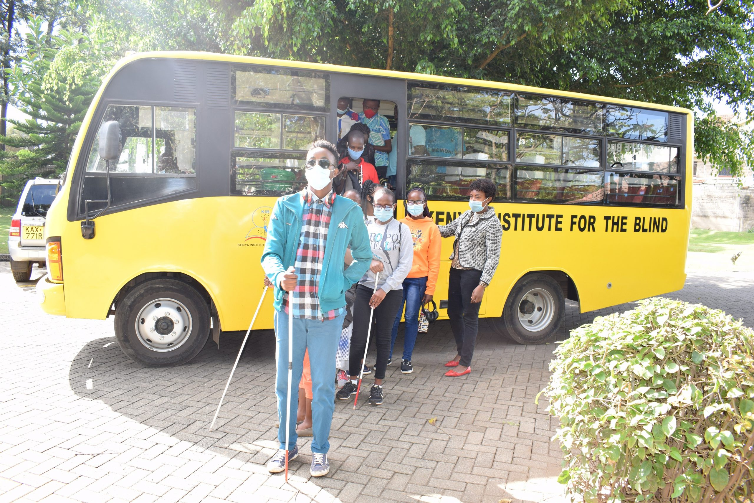 visually impaired students alighting from a school bus