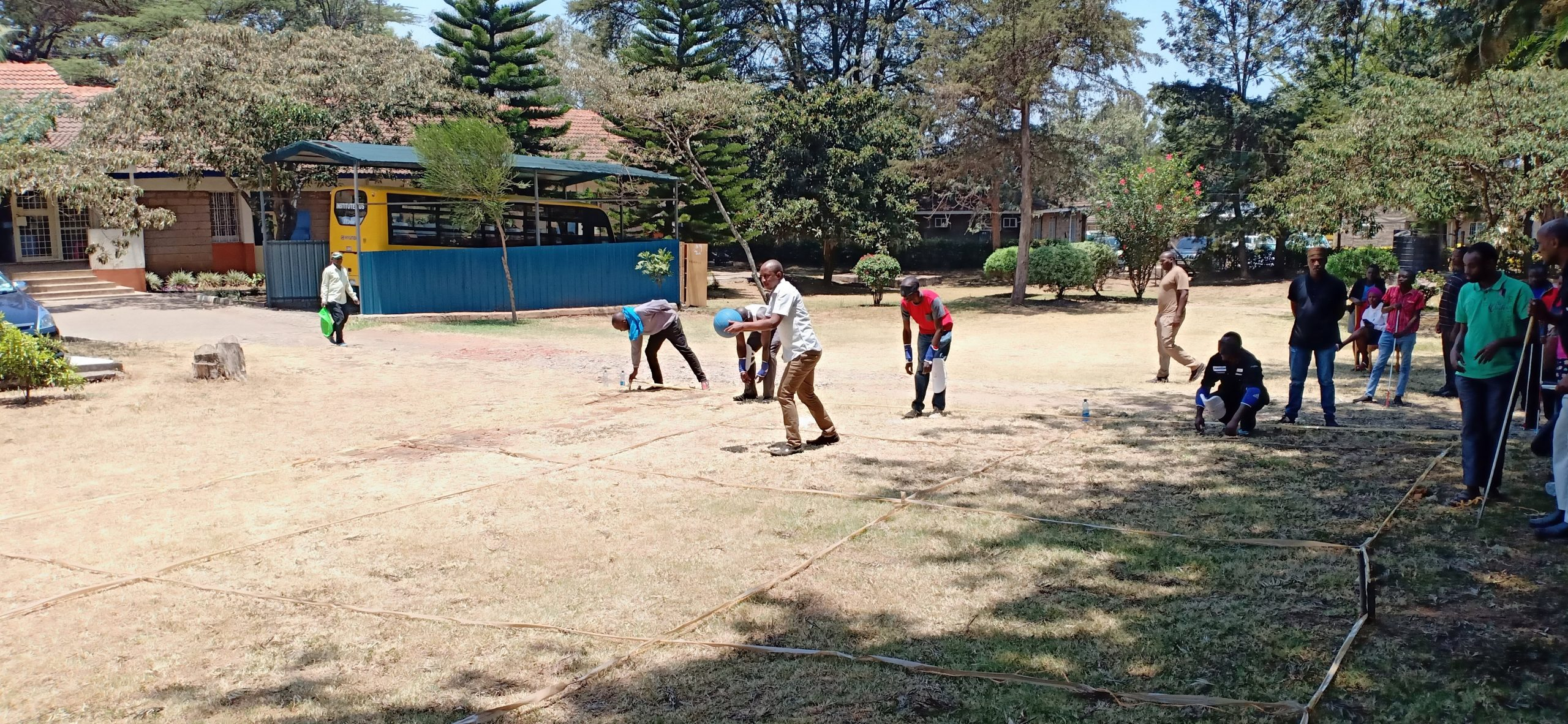Blind students playing goal ball